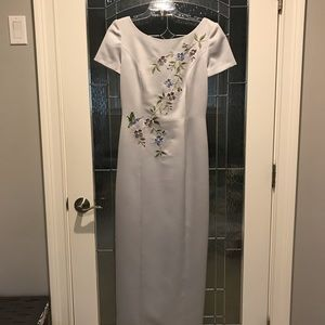 Grey satin full length dress with embroidery.